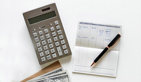 A calculator and a checkbook
